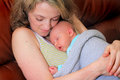 New Mom Cuddles Newborn Baby Royalty Free Stock Photo