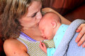 New Mom Kisses Newborn Baby Royalty Free Stock Photo