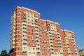 New multi-storey orange dwelling house Royalty Free Stock Photo