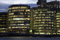 New office buildings lighted windows dusk along thames london uk Royalty Free Stock Photos
