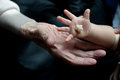 New and old hands man s hand baby s hand Royalty Free Stock Image