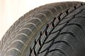 New and old winter car tires fragment a modern Stock Image