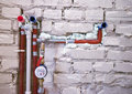 New plumbing in a wall Stock Photos
