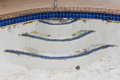 New pool tile border grout work remodel empty repair and Royalty Free Stock Photos