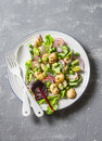 New potatoes, beans, radishes, green peas, cucumber salad with lemon mustard dressing on a gray background, top view. Healthy vege Royalty Free Stock Photo