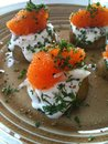 New potatoes with bleak roe and dill a plate topped creme fraiche Stock Photo