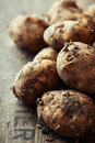 New potatoes on wooden background close up Stock Image