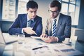 New project image of two young businessmen discussing in office Royalty Free Stock Photos