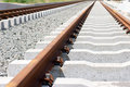 New rails the construction of a railway line for a tram with gravel and underlay sleepers Royalty Free Stock Photo