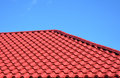 New red metal tiled roof house roofing construction exterior.