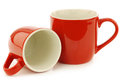 New red mugs white background Stock Photo