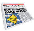 New regulations take effect newspaper headline information informing you of rules and laws impacting your life business or career Royalty Free Stock Image