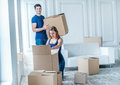 New repair and relocation. Loving couple enjoys a new apartment Royalty Free Stock Photo