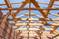 New residential construction home framing against a blue sky. Roofing construction. Wooden construction. Royalty Free Stock Photo