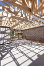 New residential wooden construction home framing. Building a roof with wooden balks. Royalty Free Stock Photo