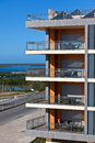 New resort apartment house against bright blue sky vertical shot Stock Photography