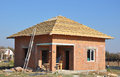 New Roof Membrane Coverings Wooden Construction Home Framing with Roof Rafters and Metal Ladder Outdoor against a Blue Sky. Royalty Free Stock Photo
