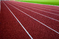 New running track with green grass abstract texture background white lines on red Stock Photo