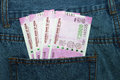 New 2000 rupee notes in an Indian mans jean back pocket. Royalty Free Stock Photo