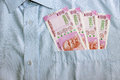 New 2000 rupee notes in an Indian mans shirts front pocket. Royalty Free Stock Photo