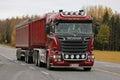 New scania rig trucking along highway kaarina finland october red v combination vehicle of kuljetus pertti j leino oy in autumn Stock Image