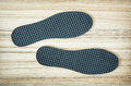 New shoe insoles on the wooden background Royalty Free Stock Photo