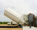A new silo arriving at a pig farm in farm in canada massive feed bin being delivered to barn southern ontario Royalty Free Stock Photo