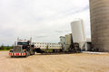 A new silo arriving at a pig farm in farm in canada massive feed bin being delivered to barn southern ontario Royalty Free Stock Photography