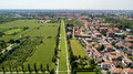 New Skyline of Milan seen from the Milanese hinterland, aerial view, tree lined avenue. Pedestrian cycle path Royalty Free Stock Photo