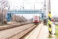 New Slovak red train under blue bridge
