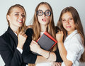 New student bookwarm in glasses against casual group on white, teen drama, lifestyle people concept Royalty Free Stock Photo