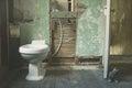 New toilet in derelict bathroom Royalty Free Stock Photo