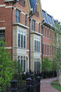 New townhouses in city luxury with brick front black fences and red brick sidewalk Stock Photo