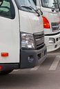 New trucks in row in parking lot closeup Royalty Free Stock Images