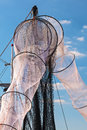 New unused fishing nets in holland hanging against a blue sky Stock Image