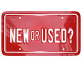 New or used license plate buy car truck a red with the words to symbolize the choice between a newly produced a pre owned other Royalty Free Stock Photo