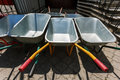 New wheelbarrows piled in row Royalty Free Stock Photo