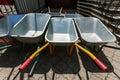 New wheelbarrows piled in row Royalty Free Stock Photo