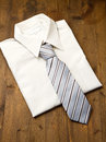 New white man s shirt and tie isolated on wood Stock Photography