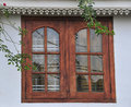 New windows in old stone wall sri lanka Stock Photo