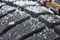 New winter tire covered with snow Royalty Free Stock Photo
