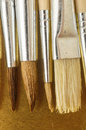 New wooden different paintbrush texture set over a colored background Royalty Free Stock Photography