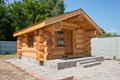New wooden house made ​​of logs in summertime Stock Image