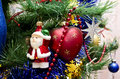 New Year background - beautiful toys on a Christmas tree - Santa Stock Photography
