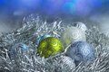 New year ball in tinsel and spangles christmas decorations Stock Photography