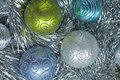 New year ball in tinsel and spangles christmas decorations Royalty Free Stock Photo