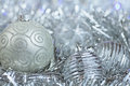 New year ball in tinsel and spangles christmas decorations Stock Photos