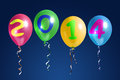 New year balloons four colorful with digits over dark blue background Royalty Free Stock Image