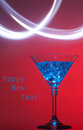 New year blue cocktail on red with splash of light background Royalty Free Stock Photo