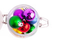 New year bright color decoration ball in glass can over white Royalty Free Stock Photo
